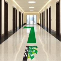 Floor decal with color right now logo and arrow pointing down hallway.